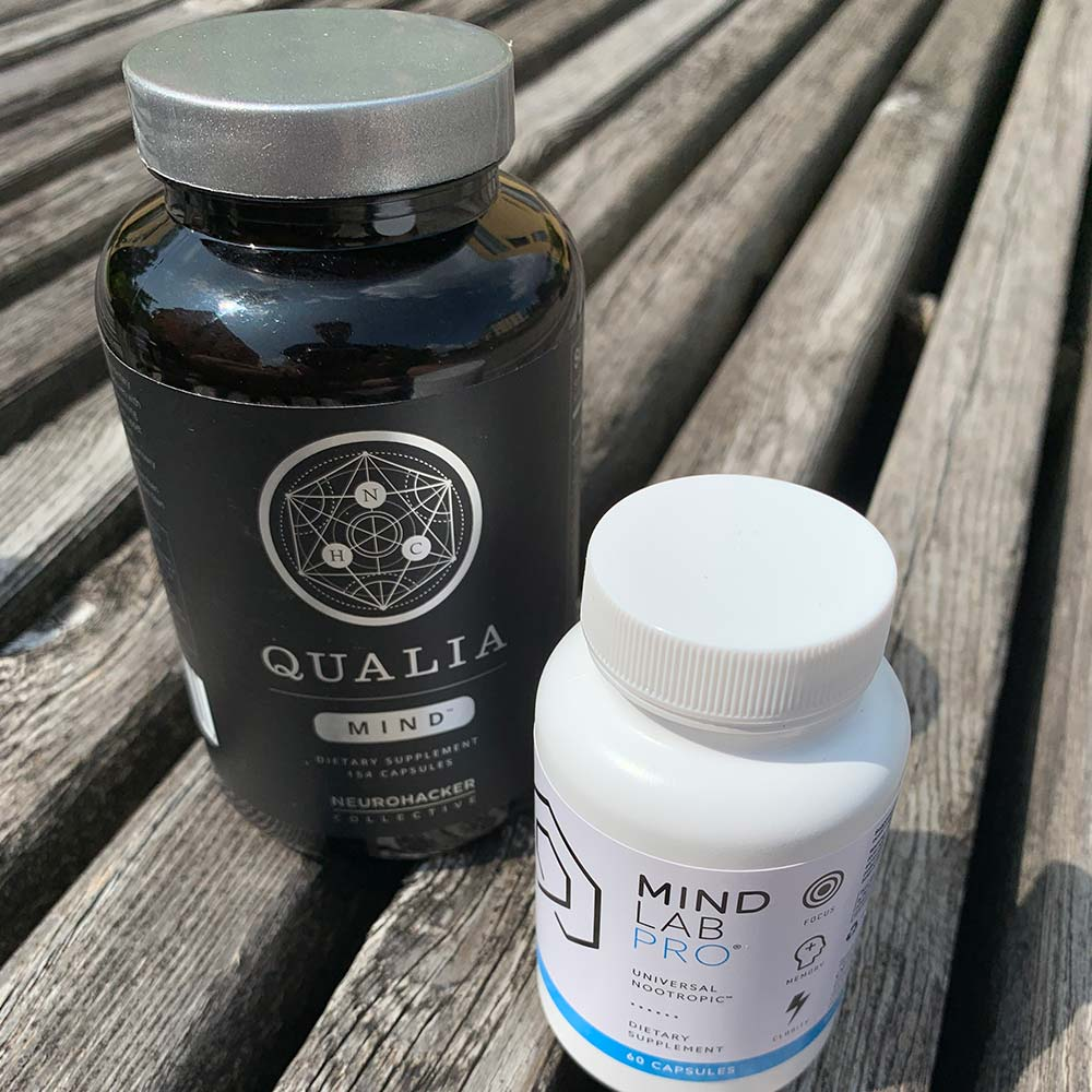 A bottle of Qualia Mind and a bottle of Mind Lab Pro