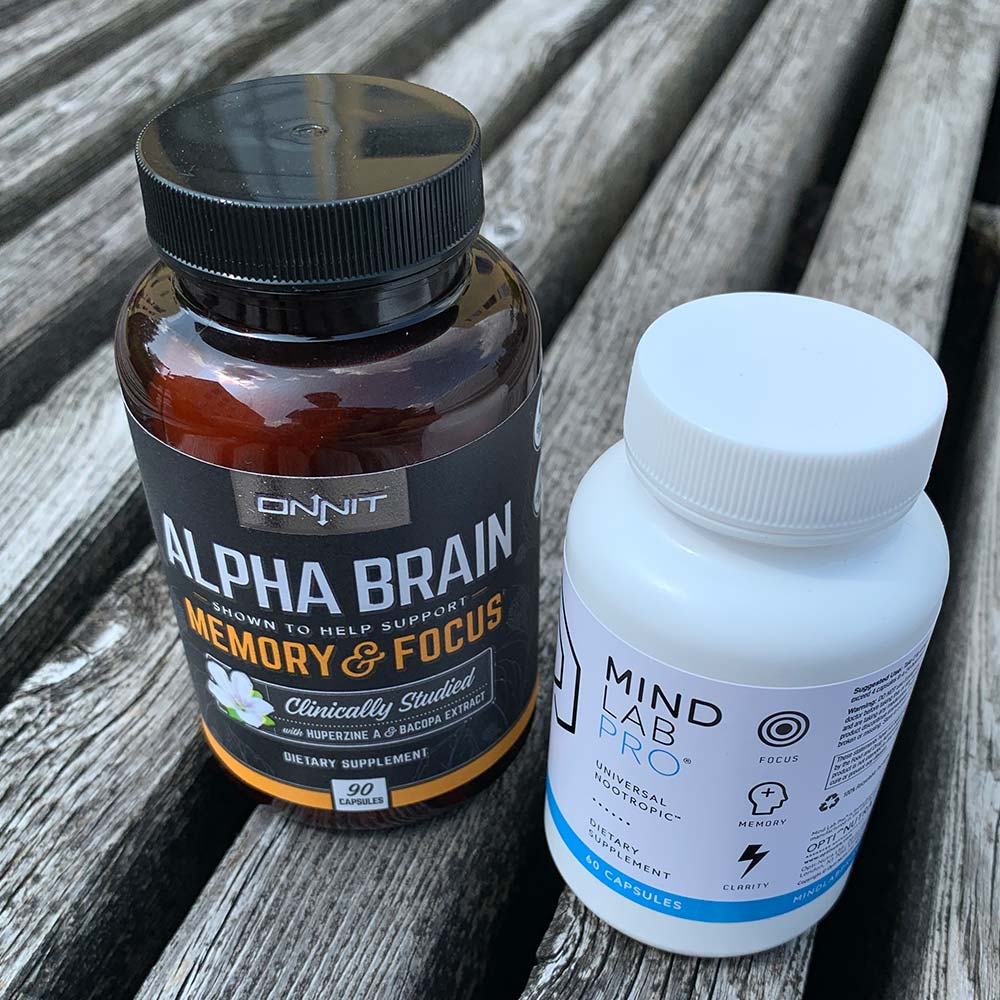 A bottle of Alpha Brain next to a bottle of Mind Lab Pro - Which nootropic is better?