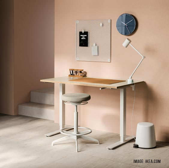 An IKEA Home Office Desk that is height-adjustable for more productivity