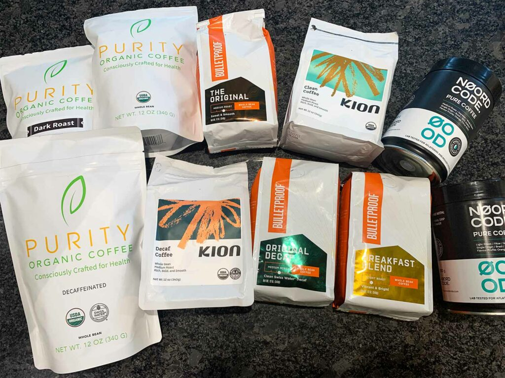 Packs of Coffee from Purity, Kion, Bulletproof and NoordCode